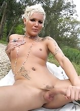 Horny tgirl posing her long hard cock outdoors