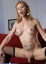 Extremely hot transsexual MILF exposing her goodies