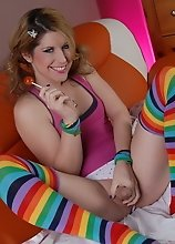 Cute Amy posing her cock while sucking a lollipop