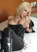 A Blonde Busty Shemale stripping in Fuck Me Boots