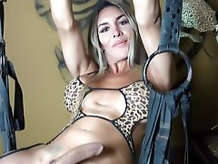 Hung tranny with Nice Titties hanging from the Sex Swing