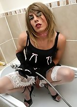 Zoe sat on the toilet wanking big cock