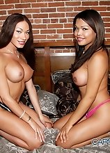 Stunning tgirls Mia & Carmen playing on the bed