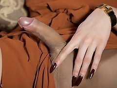 Watch Kimberlee stroking her massive thick cock on her favorite sofa until she cums